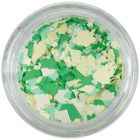 Randomly shaped confetti flakes – white, yellow, green